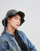 Asos Design Bucket Hat In Khaki With Aztec Band And Fastening Detail