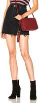 RE/DONE Highwaisted Mini Skirt in Black.