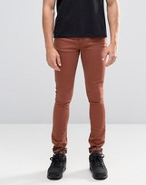 Asos Super Skinny Jeans With Camo Turn Up In Rust