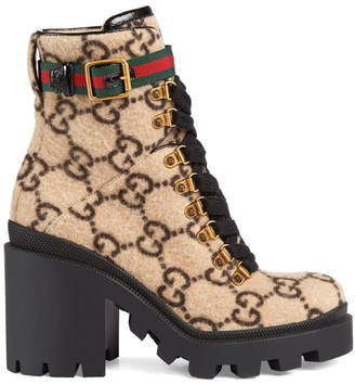 Gucci Lug Soled Heeled Ankle Boot In Gg Wool