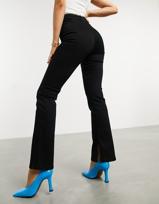 ASOS DESIGN high rise '00's' stretch flare jeans in black