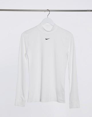Nike mini swoosh high neck long sleeve top in white