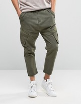 Asos Drop Crotch Cargo Pants With Raw Hem In Washed Khaki