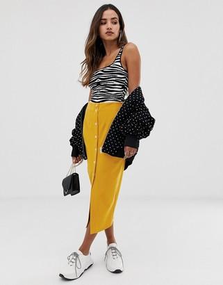 ASOS DESIGN waisted midi skirt with popper front