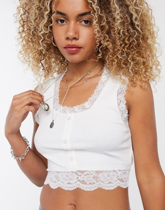 Reclaimed Vintage inspired singlet with button front and lace hem in white