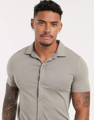 BEIGE Asos Design ASOS DESIGN organic muscle fit short sleeve jersey shirt in