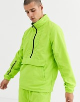 Criminal Damage co-ord nylon festival pull over with logo in neon green