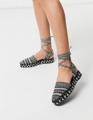 ASOS DESIGN Justify tie leg espadrilles in black
