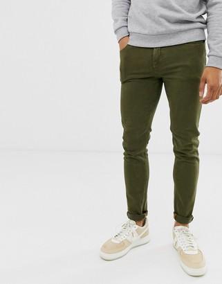 ASOS DESIGN skinny jeans in khaki