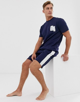 Asos DESIGN lounge pyjama short and tshirt set with collegiate number and branded waistband