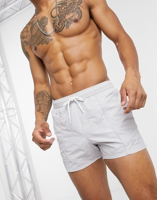 ASOS DESIGN swim shorts in grey with pintuck design and acid wash short length