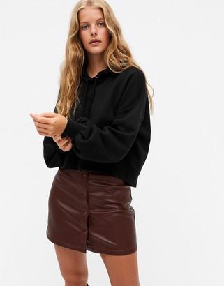 Monki Tindra organic cotton cropped hoodie in black