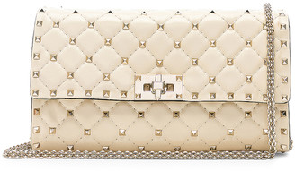 Valentino Rockstud Spike Clutch in Light Ivory | FWRD