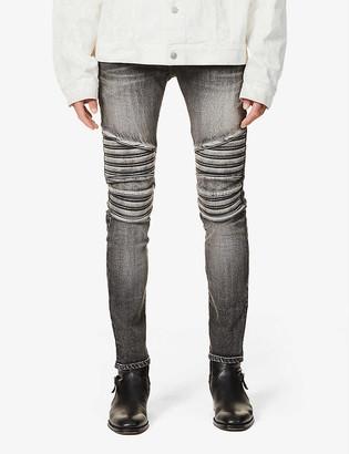 Balmain Brand-embossed ripped jeans