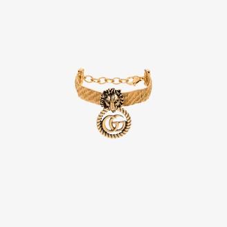 Gucci gold tone lion head GG hoop bracelet