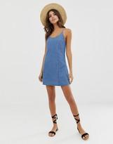 Asos Design DESIGN denim sundress with tie back in midwash blue
