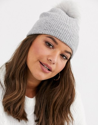 ASOS DESIGN fluffy beanie hat with faux fur pom in grey