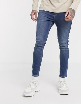 ASOS DESIGN cropped super skinny jeans in mid wash blue