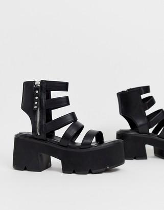 Lamoda black chunky cleated sandals