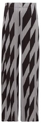 Pleats Please Issey Miyake Patterned Technical-pleated Wide-leg Trousers - Womens - Black Grey