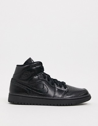 Jordan Nike Air 1 Mid in black snakeskin