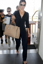 alessandra ambrosio  Who made Alessandra Ambrosios black lace jumpsuit, tan leather handbag, and espadrille flat shoes that she wore in Milan?