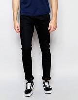 Wrangler Larston Slim Tapered Jeans In Black Tipped