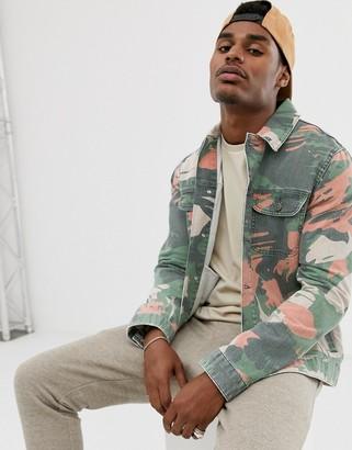 ASOS DESIGN denim jacket in camo print