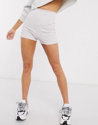 ASOS DESIGN shorter length legging short with deep waistband in rib