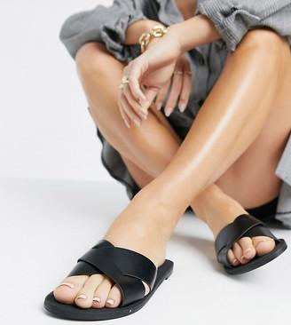 ASOS DESIGN Wide Fit Facts cross strap mule sandals in black