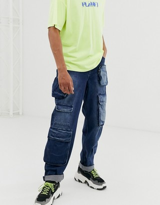 Asos Design DESIGN baggy fit cargo jeans with multi pocket in dark wash blue