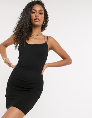 NA-KD assymetric spaghetti strap bodycon dress in black