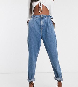 Asos Tall ASOS DESIGN Tall Tapered boyfriend jeans with D-ring waist detail with curved seams in mid blue