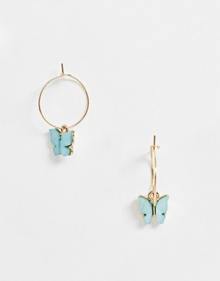 ASOS DESIGN hoop earrings with blue butterfly charm in gold tone