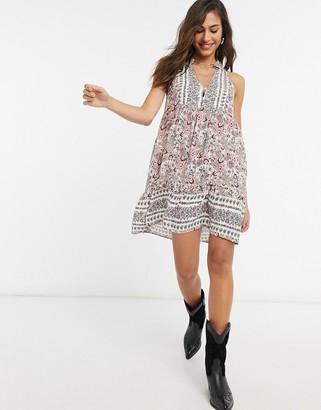 En Creme swing dress in paneled paisley print
