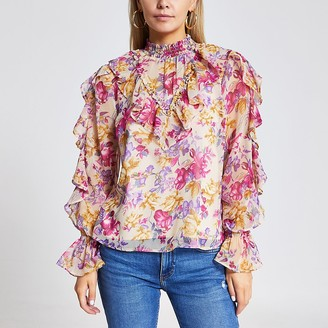 River Island Petite pink floral ruffle long sleeve blouse