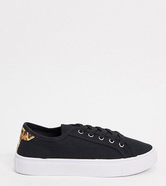 ASOS DESIGN Wide Fit Dizzy lace up trainers in black/leopard