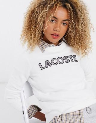 Lacoste check logo front sweatshirt in cream