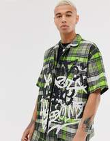 Jaded London two-piece revere collar shirt in neon green check with graffiti