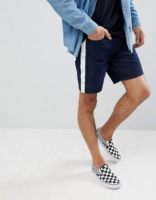 Asos Design DESIGN denim shorts in slim indigo with side stripe and poppers-Blue
