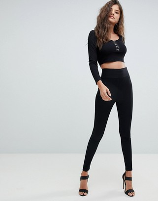 ASOS DESIGN pull on jeggings in clean black with wide waistband detail