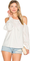 Central Park West L.A. Cold Shoulder Blouse in White. - size L (also in M,S,XS)