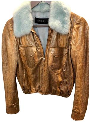 Gucci Gold Fur Coats