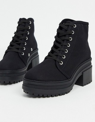 ASOS DESIGN Reflect heeled canvas boots in black