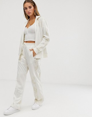 adidas x Danielle Cathari deconstructed Firebird track pant in white