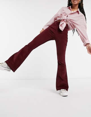 Hollister cord flare trousers in burgundy