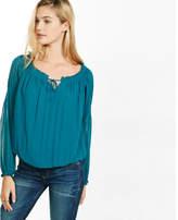 Express off the shoulder smocked tie-neck blouse