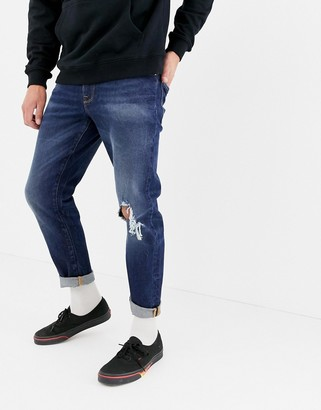 ASOS DESIGN 12.5oz tapered jeans in dark wash blue with rips