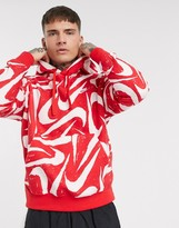 Nike Club Essentials all over logo print hoodie in red