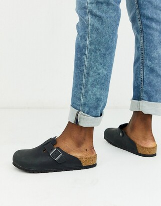 Birkenstock Boston mules in black oiled leather